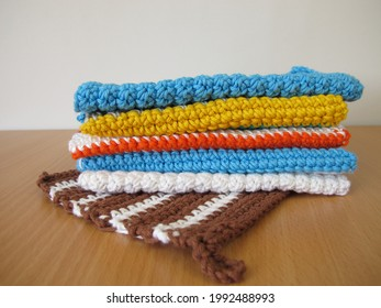 Reusable and washable crocheted and knitted dishcloths from wool, cotton and wool scraps