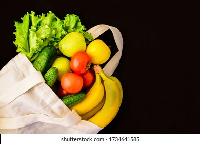 Reusable zero waste textile product shopping bag with groceries vegatables, copy space for text, Different vegetables in textile bag