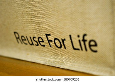 """""""Reuse For Life"""" text on calico bags, concept for save a nature"""