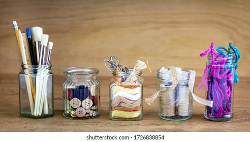 Reused jars reused for storing crafting materials, recycling at home for sustainable living, save money and zero waste
