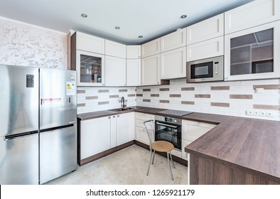 Reutov, Russia - December 21, 2018: Interior of the kitchen in the luxury rich apartments.