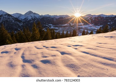 Reutte at sunset with snow and mountains in the background, Tyrol, Austria
