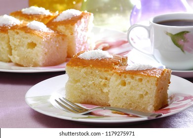 revane, revani, traditional ethnic dessert sponge cake with syrup, blurred decorated background