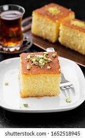 Revani - sweet semolina cake with pistachio, traditional turkish dessert