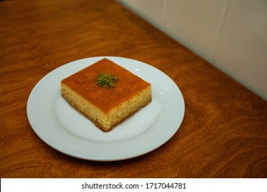 revani - in a white plate; sweet semolina cake with pistachio