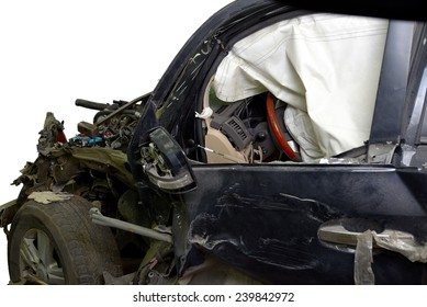 Revealed safety cushion in the very crumpled car in road accident isolated