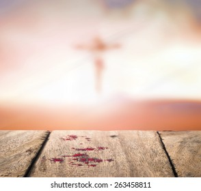 Revelation of holy bible concept: Blood on wood and blurred Jesus Christ on the cross