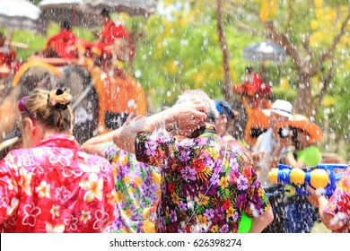 Revelers enjoy water splashing with elephants during Songkran Festival in Ayutthaya,Thailand. Water splashing is the way Thai people celebrate New Year.Blur background.