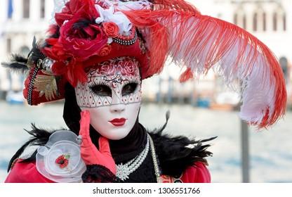 Reveller In Traditional Elaborate Mask And Costume At Venice Carnival (Carnevale di Venezia). Venice, Veneto, Italy, Europe