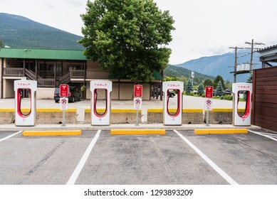 Revelstoke, BC, Canada - June 28, 2018: Tesla Supercharger Station in a Parking Lot. Tesla is an American automotive specialized in Electric Cars.
