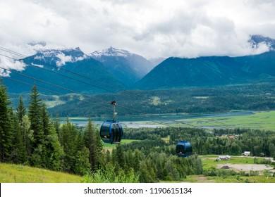REVELSTOKE, BRITISH COLUMBIA, CANADA, JUNE 25, 2016: Two chairlifts from the Revelstoke Mountain Resort  gondola going uphill in summer, British Columbia, Canada