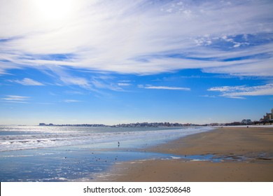 Revere Beach on a sunny day with Boston in the background