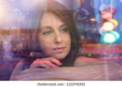 reverie and thoughts - a woman looks out the window