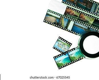 Reversal film and magnifying glass loop isolated on white background