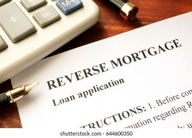 Reverse mortgage loan application on a table.