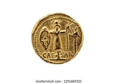 Reverse side of a Roman Aureus Gold Coin replica of Julius Caesar with a Trophy of Gallic Arms  struck between 48-47 BC cut out and isolated on a white background