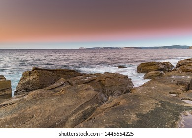 Reverse Sunrise Seascape - Putty Beach in the Bouddi National Park on the Central Coast, NSW, Australia.