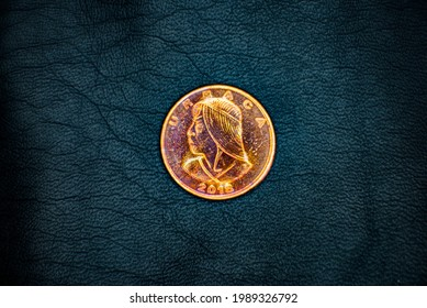 Reverse of used and old Panamanian 1(one) centesimo(cent) coin, minted in 2018, on black leather background. Portrait of Urraca.