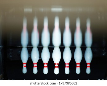 reversed image of Skittles for bowling,bowling game. Pins at the end of a bowling alley. skittles reflection