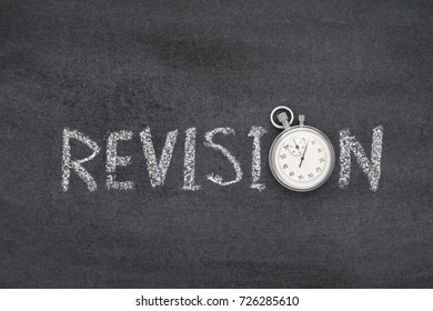 revision word handwritten on chalkboard with vintage precise stopwatch used instead of O