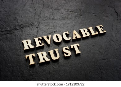 Revocable trust words on the dark background.