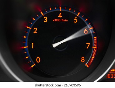 Revolution counter of a sport car showing engine revving