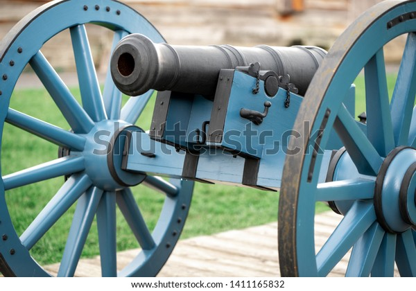 A Revolutionary War Cannon Close Up with a Blurry Background.