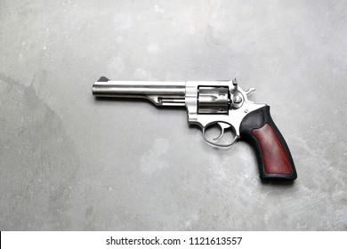 Revolver black powder. Revolver on a gray background