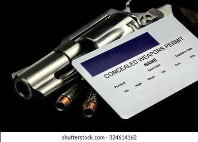 Revolver and Bullets and Concealed Weapon Permit. Selective focus and depth of field.