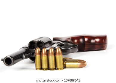 Revolver and bullets isolated on white background