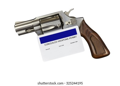 Revolver with CCW Gun Permit Isolated on White Background. Closeup. Studio Props. No Releases Needed.