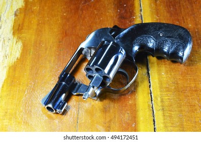 revolver gun without bullet on wooden table