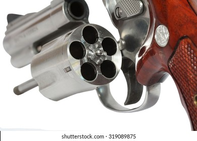 Revolver open chamber ready to put bullet isolated on white background