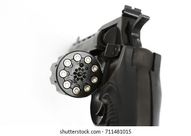 revolver with open gun drum and isolated on a white background