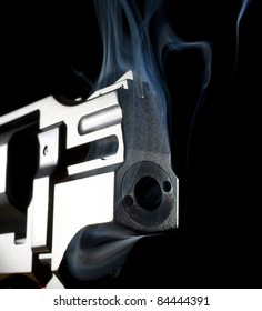 revolver that has been shot and is smoking hot