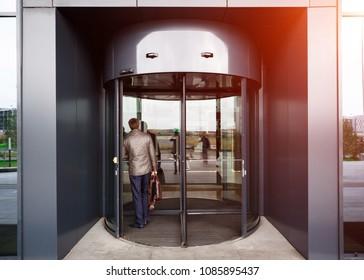 Revolving door in reception of office building.