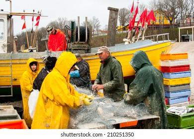 REWAL, POLAND - CIRCA MAY 2013: Fishermen at work circa May 2013 in Rewal.