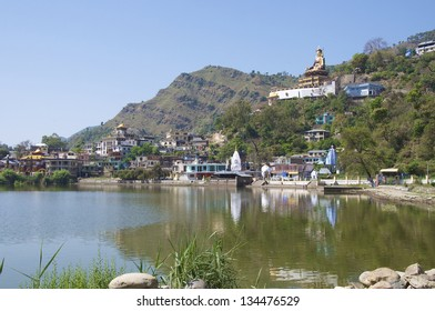 Rewalsar Lake with Statue of Padmasambhava, view. Himachal Pradesh, India.  Sacred Buddhist site. 37.5 metres high and inaugurated by H.H the 14th Dalai Lama of Tibet.
