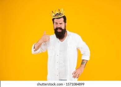 reward concept. brutal guy prince yellow background. King of party. Egoist selfish man. Superstar concept. Royal status. Sense of self importance. Love yourself. Holiday carnival celebration.