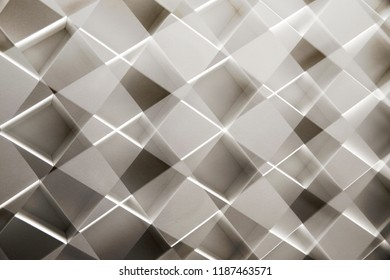 Reworked photo of cellular wall structure of modern architecture building. Abstract mosaic background with irregular zigzag composition / pattern in shades of gray.