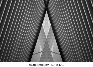 Reworked photo of louvered structure. Realistic though unreal hi-tech interior with triangular corridor / doorway under  pitched roof / ceiling. Modern architecture of a transparent office building.