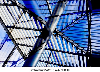 Reworked photo of office building exterior fragment featuring metal pillar and louvered roof / ceiling. Abstract image on the subject of modern architecture, construction industry or technology.