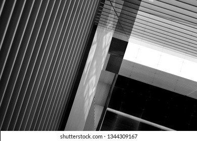 Reworked photo of pitched ceiling with louvered structure. Fragments of hi-tech industrial or office building interior with striped pattern. Abstract modern architecture background in black and white.