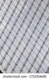 Reworked photo of steel-and-glass wall of skyscraper. Abstract modern architecture of minimalist business building exterior. Hi-tech geometric background with linear pattern in diagonal composition.