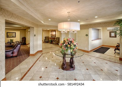 Rexburg, Idaho, USA Oct. 23, 2014 The foyer in a newly constructed apartment complex, with warm yellow colors, decorative tile, and coiffured ceilings.