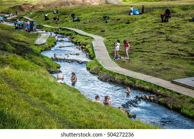 REYKJADALUR, ICELAND August 22: Swimming in the thermal stream near Reykjavik on August 22, 2016.