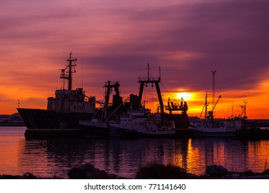Reykjanesbaer, Iceland - December 8, 2017 : Old fishing boats in port at sunrise.