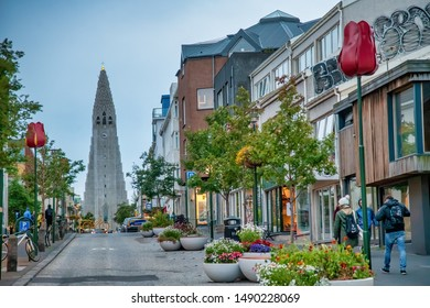 REYKJAVIK, ICELAND - AUGUST 11, 2019: City street with Cathedral on the background. The city hosts most of the island population.