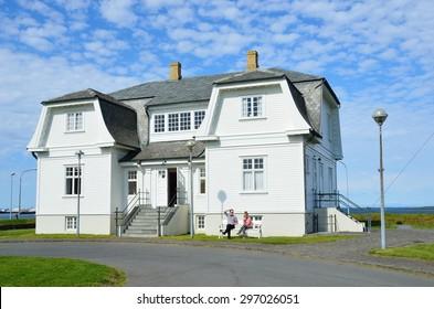 Reykjavik, Iceland, August, 12, 2014. People sitting near the house of Hevdi