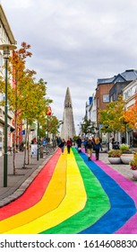 REYKJAVIK, ICELAND - AUGUST 26, 2019 Hallgrimskirkja Large Lutheran Church Colorful Rainbow Shopping Street Toursits Shoppers Reykjavik Iceland. Largest church and tallest structure in Iceland.